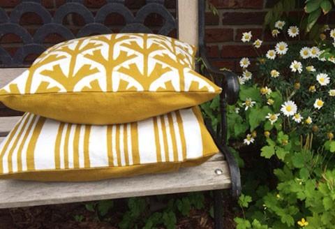 Laat je tuin of terras stralen met deze kussens